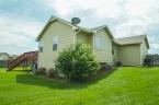 McCurdy Auction - (NE) 4-BR, 3-BA Home w/ 3-Car Gar & BSMT