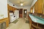 McCurdy Auction - (LORRAINE) ABSOLUTE - 2-BR, 2-BA Home w/ 1-Car Gar