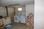 McCurdy Auction - (Hutchinson) 2-BR, 1-BA Home w/ 1-Car Garage & BSMT