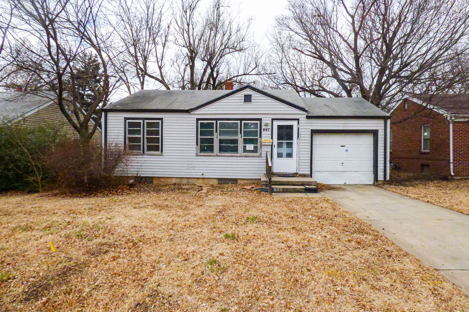 McCurdy Auction - (NE) 2-BR, 1-BA Home w/ BSMT and Attached 1-Car Gar.