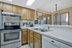 McCurdy Auction - (NE) 3-BR, 1.5-BA Townhome w/ 2-Car Garage